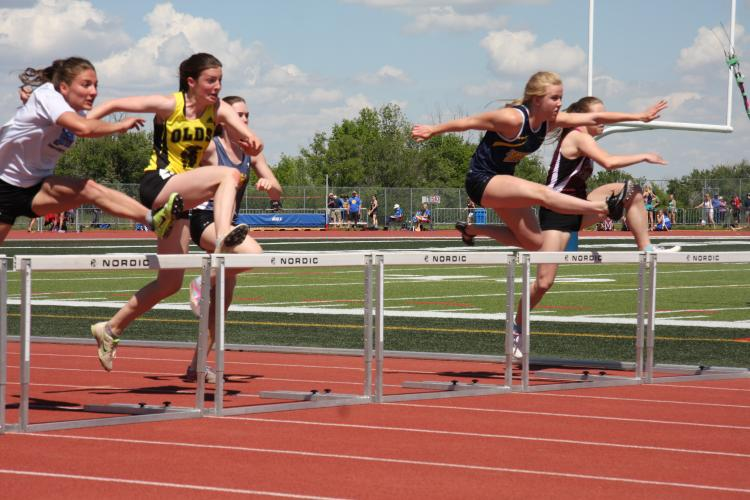 Girls Jumping Hurdles